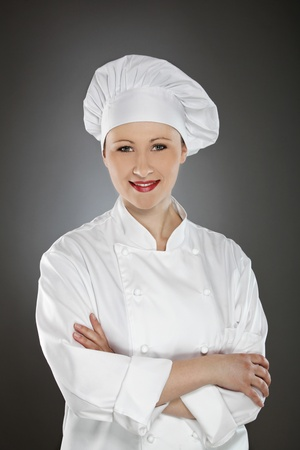 Confident young female chef with arms crossed  photo
