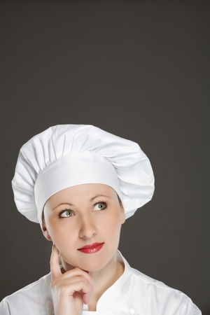 Young female chef  thinking -   bubble with copy space Stock Photo - 12883314