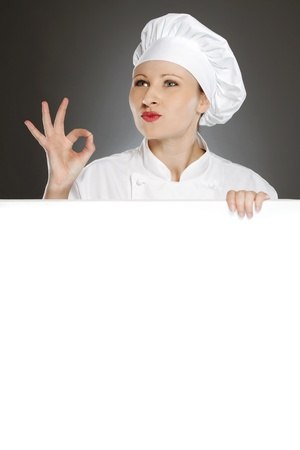 Female chef showing positive gesture with blank copy space photo