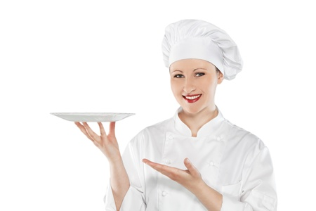 Female chef holding empty plate isolated on white