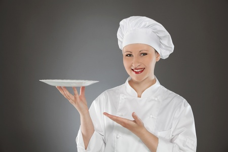 Female chef holding empty plate Stock Photo - 12883313