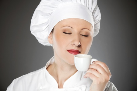 Young female chef enjoying on the coffee break photo