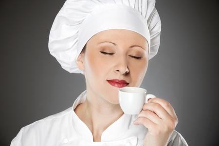 Young female chef enjoying on the coffee break Stock Photo - 12883315