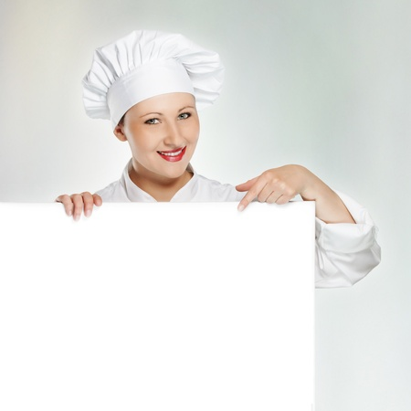 Young female chef showing todays menu photo