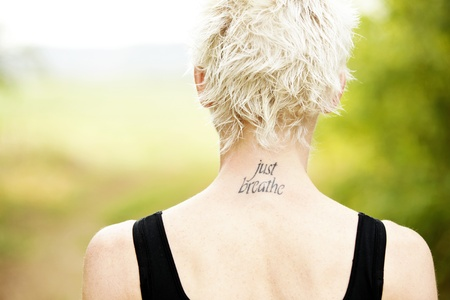 View of female runner back with tatoo