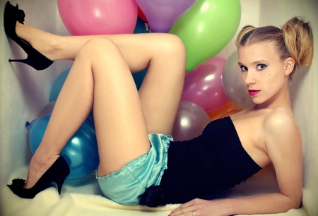 ly: Young attractive woman posing with baloons Stock Photo