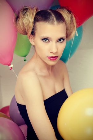cross procesed: Young attractive woman posing with baloons Stock Photo