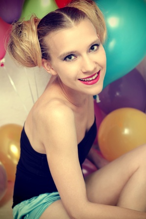 cross procesed: Young happy woman posing with baloons Stock Photo