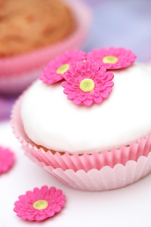 Tasty cupcake with floral decoration photo