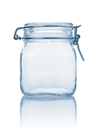 Closed empty glass jar, blue tonned and isolated on white