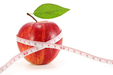 Apple with measuring tape on white Stock Photo