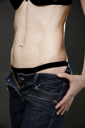 girl belly: Body of young fit woman in jeans Stock Photo