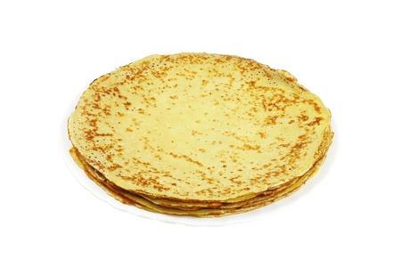 rubicund: Pancakes on white plate isolated on white  Stock Photo