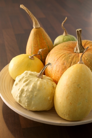 Decorative pumpkins on wooden plate Stock Photo - 15791084