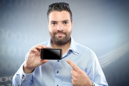 Handsome young man with smart phone against digital background Stock Photo - 15763911