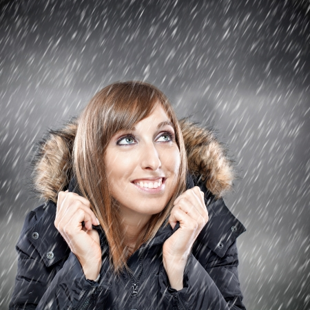 Happy young woman enjoying snow in winter Stock Photo - 15985400