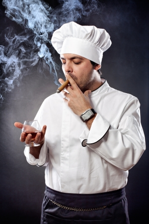 Chef with cigar and glass of cognac Stock Photo - 15985359
