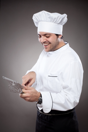 Chef with digital tablet against grey background photo