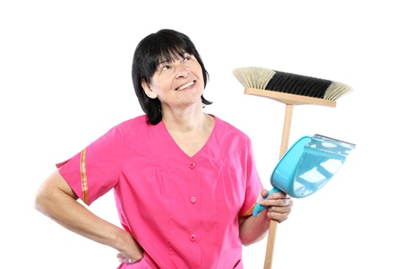 Middle aged cleaning lady with broom and scoop isolated on white Stock Photo - 16065449