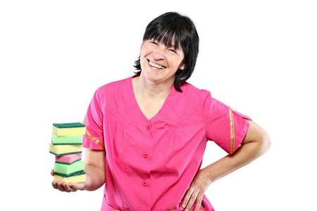 Middle aged cleaning lady with sponges isolated on white Stock Photo - 16065452