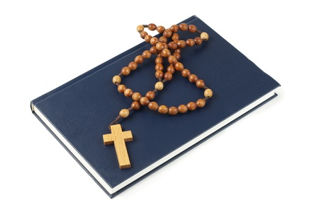 Holy Bible and rosary breads isolated on white Stock Photo - 16065443