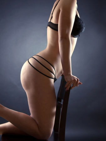 Seductive woman in black lingerie on chair Stock Photo - 16065451