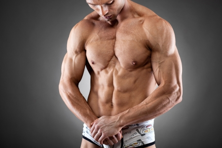 man underwear: Handsome young fit and muscular man posing  Stock Photo