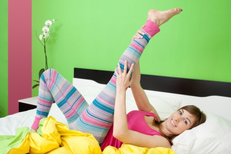 Cute caucasian woman stretching in bed Stock Photo - 17008673