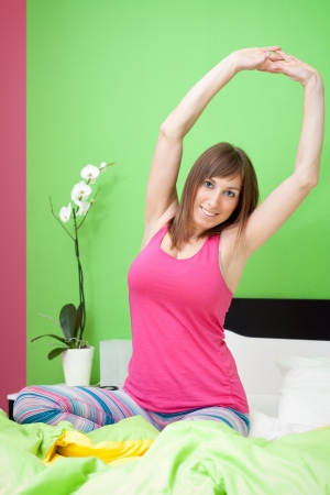 Cute caucasian woman stretching in bed Stock Photo - 17008668
