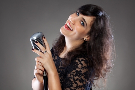 Attractive young brunette woman with a retro microphone  photo