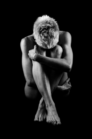 Naked woman on black background. Fine art photo of female body. Stock Photo - 17055816