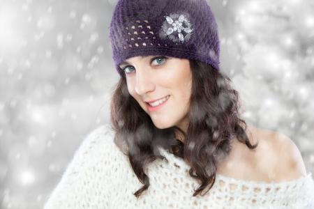 Beautiful young woman with knitted hat in winter Stock Photo - 17104307