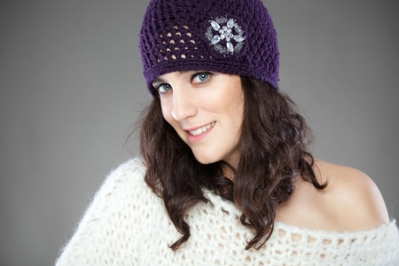 ordinary: Beautiful young woman with knitted hat in studio Stock Photo