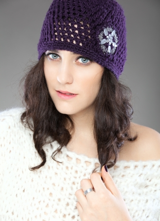 Beautiful young woman with knitted hat in studio Stock Photo - 17369575