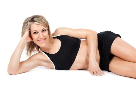 Attractive young fit woman lying on white background Stock Photo - 17456598