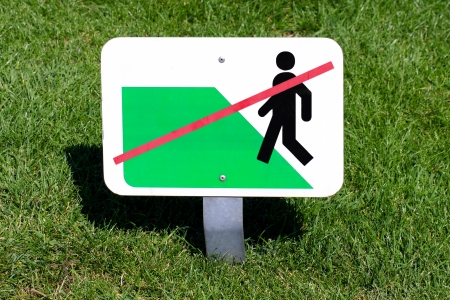 Green grass and sign of forbidden walk Stock Photo - 18048727
