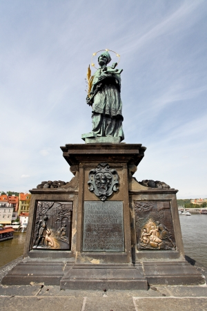 Statue of Sf. John of Nepomuk on the Charles bridge in Prague,Czech Republic Stock Photo - 18094752