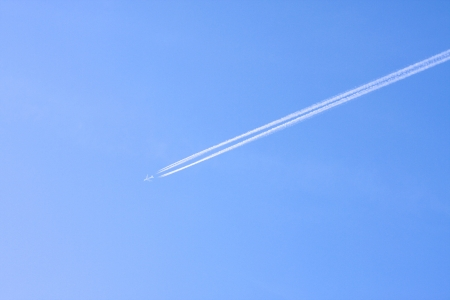 contrail: Airplain with contrail in summer sky