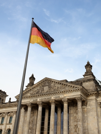 Reichstag in Berlin wih German flag against blue sky Stock Photo - 18080347