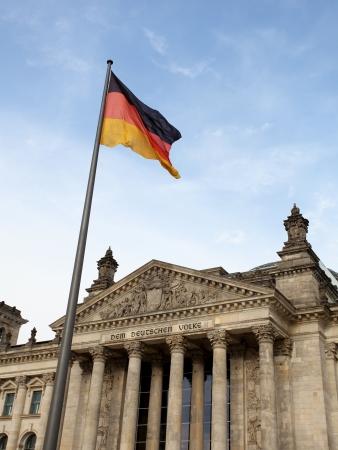 Reichstag in Berlin wih German flag against blue sky Stock Photo - 18080347