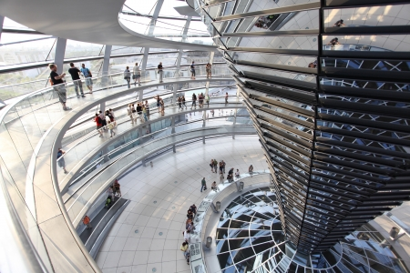 BERLIN, GERMANY - AUGUST 20: People visit the Reichstag dome at the German parliament August 20, 2012 in Berlin, Germany Stock Photo - 18080346