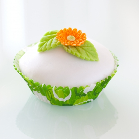 Beautiful  cupcake decorated with flower and leaves photo