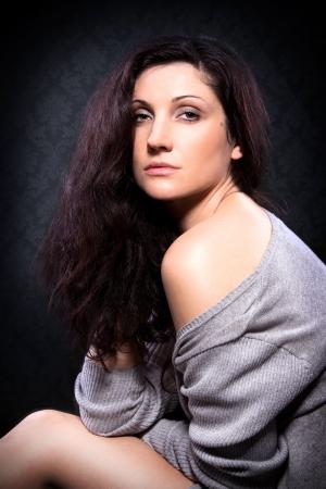Beautiful young woman posing in studio Stock Photo - 18359695