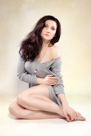 Beautiful sensual young woman posing in studio photo