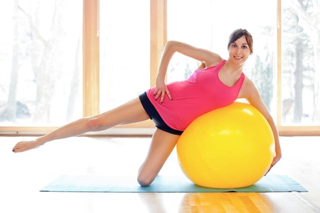 Young fit woman with fitness ball Stock Photo - 18499554
