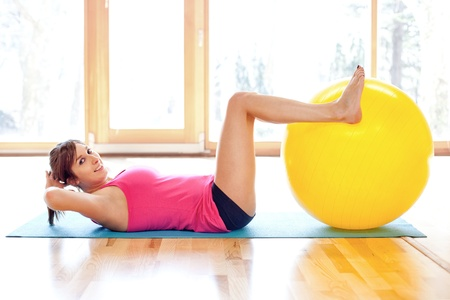 Young fit woman with fitness ball Stock Photo - 18499557