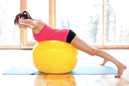 Young fit woman with fitness ball Stock Photo - 18499556