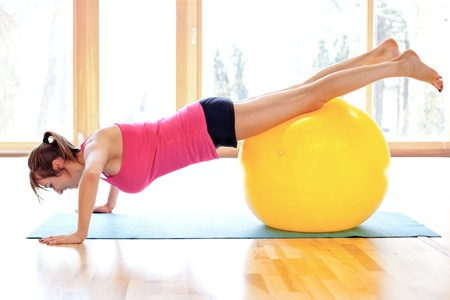 Young fit woman with fitness ball Stock Photo - 18499555