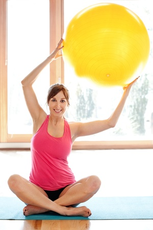 Young fit woman with fitness ball Stock Photo - 18499558