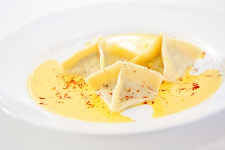 Three ravioli served on white plate Stock Photo - 18702310